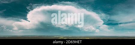 Aerial View. Amazing Natural Dramatic Sky With Rain Clouds Above Countryside Forest Landscape In Summer Cloudy Day. Scenic Sky With Fluffy Clouds On