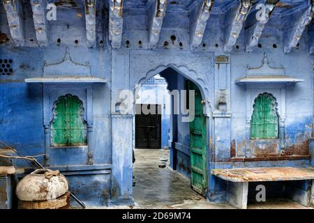 View of a street in Jodhpur with the facades of houses painted blue. Rajasthan. India.