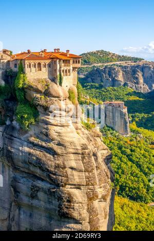 Greece. Summer sunny day in Meteora. Two monasteries on high cliffs.