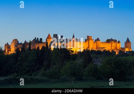 Carcassonne, Languedoc-Roussillon, France.  The medieval city at dusk.  The Cite de Carcassonne is a UNESCO World Heritage Site.