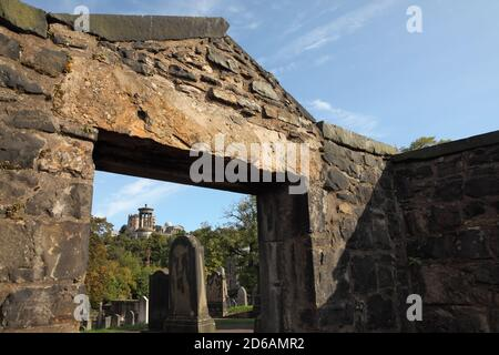 Monuments and gravestones in Old Calton cemetery (opened 1718) with Calton Hill behind, Edinburgh, Scotland. - Stock Photo