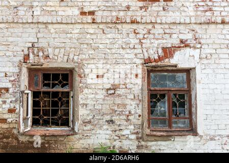 Old abandoned house with broken windows and walls