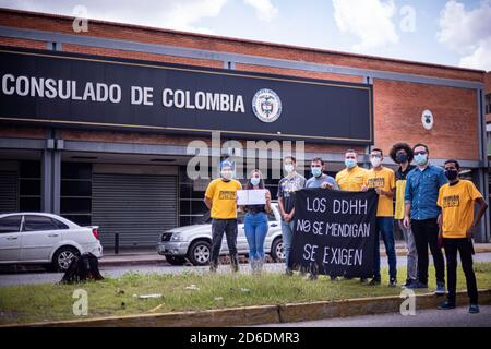 Valencia, Valencia, Venezuela. 16th Oct, 2020. THE YOUNG PEOPLE OF THE PRIMERO JUSTICIA POLITICAL PARTY, REPORTED THIS MORNING, TO THE CONSULATE OF COLOMBIA IN THE Valencia OF VALENCIA, CARABOBO IN VENEZUELA, ABUSE OF HUMAN RIGHTS TO WHICH VENEZUELANS ARE SUBJECTED Credit: Elena Fernandez/ZUMA Wire/Alamy Live News - Stock Photo
