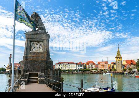 Lindau, Germany - July 19, 2019: Lion statue at harbor entrance on Lake Constance (Bodensee). Old town of Lindau is tourist attraction of Bavaria.