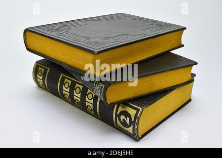 Old books on a white background. vintage books with gold leaf - Stock Photo