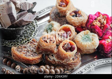Arabic, Lebanese and Turkish sweets kataifi and kanafeh, a Traditional Eastern dessert made of thin dough with syrup , nuts and seeds. Close up