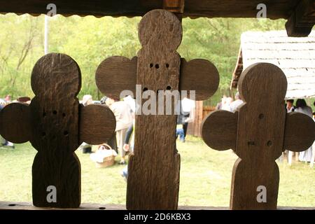 The 18th century Christian Orthodox church in Leleasca, Olt County, Romania. Close-up of the hand-sculpted wooden crosses on the traditional porch.