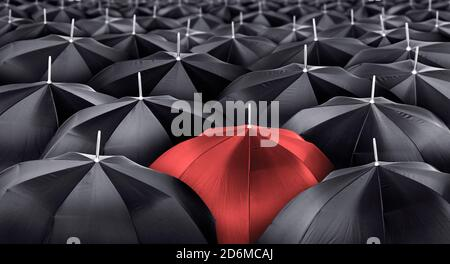 Different, unique and standing out of the crowd red umbrella. Leader or being different concept