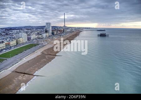Brighton Seafront an aerial image along the historic coastline of this south coast resort, with the sun rising over a calm sea.