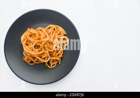 Spaghetti Bolognese are one of the most typical and well-known ways of making. It consists of a paste, seasoned with a sauce whose ingredients are tom - Stock Photo