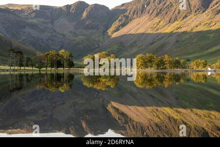 Summer early morning reflections on Buttermere in the Lake District, Cumbria England UK