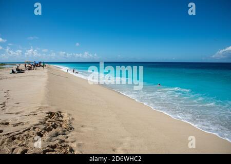 Frederiksted, St. Croix, US Virgin Islands-December 22,2019: Tourists relaxing and swimming at Sandy Point's Caribbean Sea waters on St. Croix.