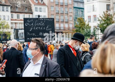 Strasbourg, France - Oct19, 2020: Freedom I write your name placard as people pay tribute to history teacher Samuel Paty, beheaded on Oct16th after showing caricatures of Prophet Muhammad in class