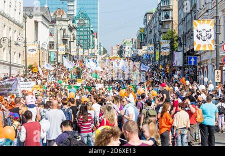 Russia, Vladivostok, 09/29/2019. Annual festive Tiger Day in downtown. Parade in honor of protecting Siberian tiger. Many people walk by urban city. H - Stock Photo
