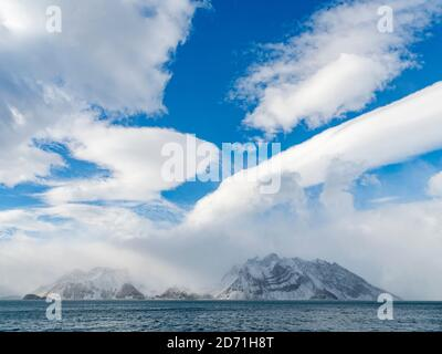 Royal Bay with typical dramtatic clouds, South Georgia. Antarctica, Subantarctica, South Georgia, October - Stock Photo