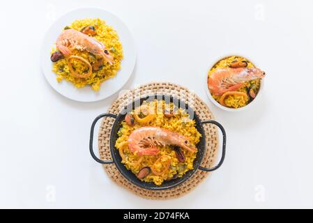 Paella typical spanish food in granite background - Stock Photo