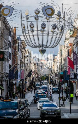London, UK. 20th Oct, 2020. Christmas decorations are now up in New Bond Street. Credit: Guy Bell/Alamy Live News