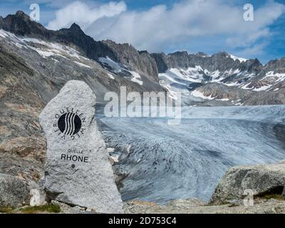 Monument above the Rhone glacier, to mark the source of the Rhone River, Switzerland. - Stock Photo