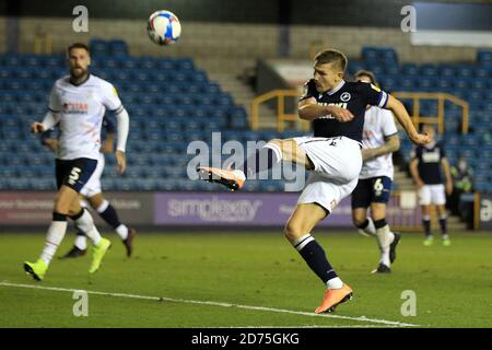 London, UK. 20th Oct, 2020. Shaun Hutchinson of Millwall takes a shot at goal. EFL Skybet Championship match, Millwall v Luton Town at the Den in London on Tuesday 20th October 2020. this image may only be used for Editorial purposes. Editorial use only, license required for commercial use. No use in betting, games or a single club/league/player publications. pic by Steffan Bowen/Andrew Orchard sports photography/Alamy Live news Credit: Andrew Orchard sports photography/Alamy Live News