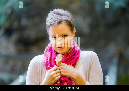 Charming charismatic photogenic appealing Portrait isolated hands hold holding fallen leaf Fall Autumn country-side countryside countrygirl teengirl - Stock Photo
