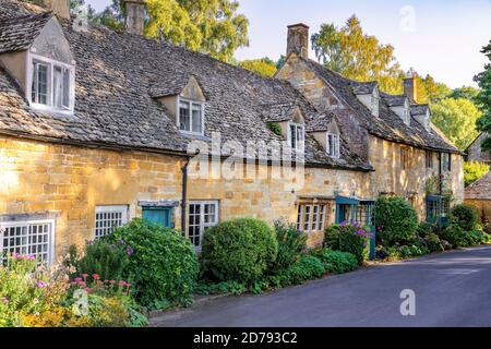 Evening light on traditional stone cottages in the Cotswold village of Snowshill, Gloucestershire UK