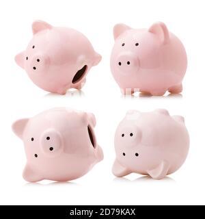 Set of pink ceramic piggy banks isolated on white background