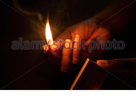 KINGSTON, JAMAICA - Oct 02, 2020: Matches Light in the dark night, warm and well-lit photo.
