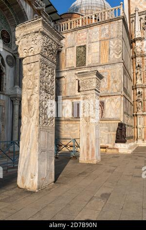 The Pillars of Acre on the south wall of St Mark's Basilica with the Portrait of the Four Tetrarchs in the background, Piazza San Marco, Venice, Italy - Stock Photo