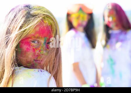positive and cheerful. colorful neon paint makeup. children with creative body art. fashion youth party. Optimist. Spring vibes. Crazy hipster girls