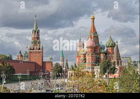 = Spasskaya Tower and St. Basil's Cathedral in Autumn Season =  Beautiful cityscape with the view from Zaryadye park on the most famous Moscow landmar