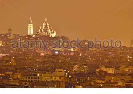Beautifull distant view of Montmartre and Basilica of the Sacré-Coeur from Triumph Arc - Stock Photo