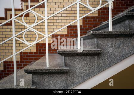 Old historic building with luxury stairs and tiled wall, beautiful marble design of old building and white handrail