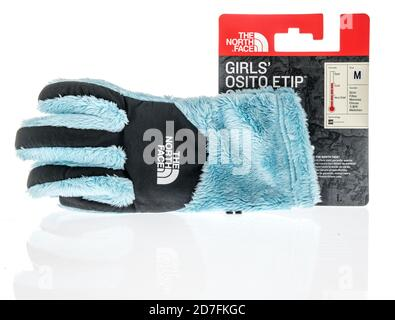 Winneconne, WI - 18 October 2020:  A package of The North Face gloves for the winter on an isolated background. - Stock Photo
