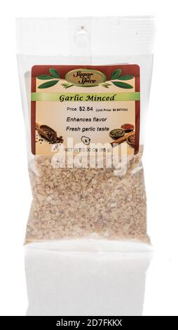 Winneconne, WI - 18 October 2020:  A package of Supar n spice minced garlic on an isolated background. - Stock Photo