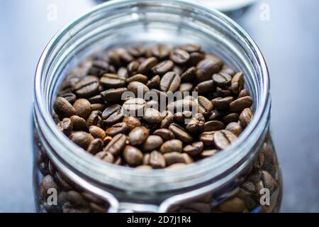A close up of roasted coffee beans in a glass container in Kandy, Sri Lanka