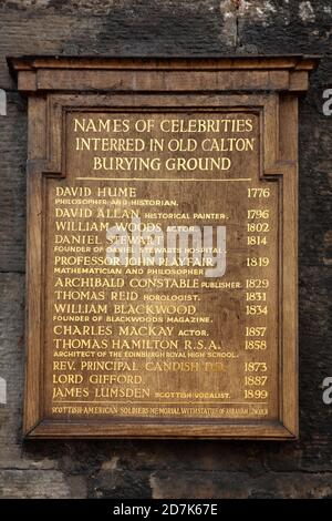 Plaque listing well-known people buried in Old Calton Burial Ground, Edinburgh, Scotland. - Stock Photo