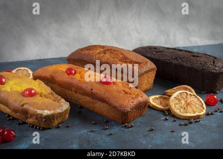 Tasty homemade sweet bakery products with cherry, lemon and chocolate - Stock Photo
