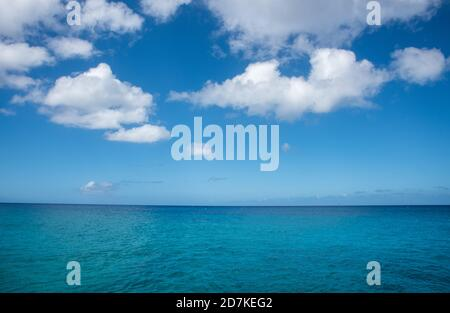 Stunning turquoise Caribbean Sea waters under a blue sky with clouds off Sandy Point shore in Frederiksted on St. Croix in the US Virgin Islands