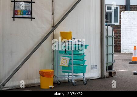 NHS drive through flu clinic providing influenza jabs vaccinations immunizations, Surrey, UK - Stock Photo