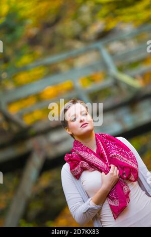 Shorthaired short hair haired teengirl as countrygirl portrait standing eyeshot eyes eye contact looking at camera tilt tilted serious - Stock Photo