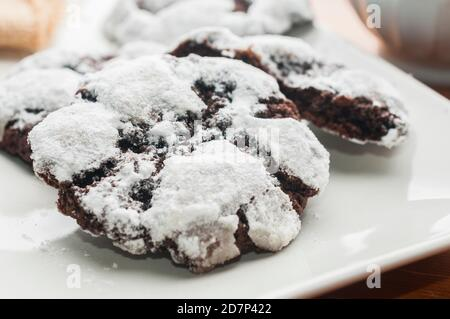 Double chocolate crinkle cookies on white plate - Stock Photo