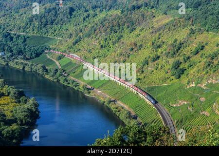 GERMANY,Moselle, Cargo train passing the 800 m  long viaduct of Puenderich in the Moselle Valley.