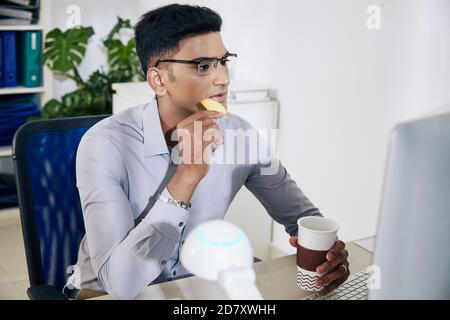 Software developer drinking coffee