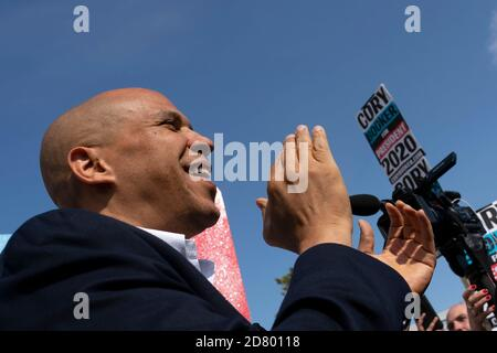 2020 Democratic Presidential hopeful Senator Cory Booker, a Democrat from New Jersey, greets supporters as he arrives at a rally outside the building where the Wing Ding Dinner will take place on August 9, 2019 in Clear Lake, Iowa. The dinner has become a must attend for Democratic presidential hopefuls ahead of the of Iowa Caucus. Credit: Alex Edelman/The Photo Access