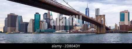 New York, NY, USA - October, 2017: Skyline of Manhattan downtown, New York City, with skyscrapers. View from under Brooklyn bridge Stock Photo