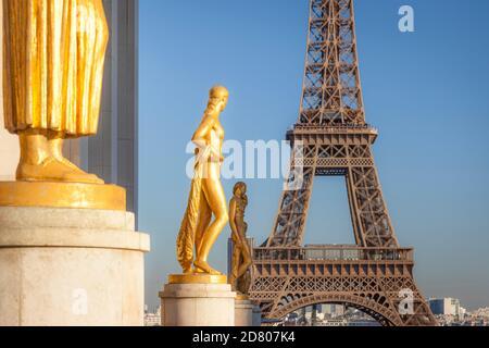 Gold figures line Place du Trocadero with Eiffel Tower beyond, Palais de Chaillot, Place du Trocadero, Paris, France - Stock Photo