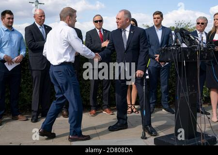 House Minority Whip Steve Scalise, a Republican from Louisiana, shakes hands with Representative Jim Jordan, A republican from Ohio, after speaking during a press conference on gun violence outside the U.S. Capitol in Washington, D.C., U.S., on Wednesday, Sept. 19, 2019. Credit: Alex Edelman/The Photo Access