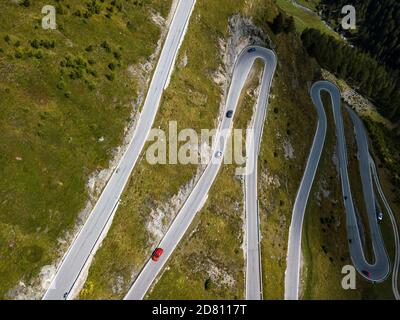 Aerial top view on scenic curvy mountain pass road to the Timmelsjoch at the border of Italy and Austria in the Alps