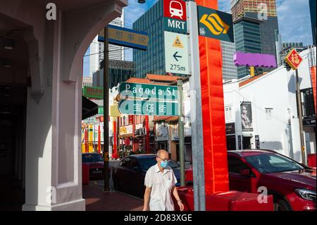 16.10.2020, Singapore, Republic of Singapore, Asia - A street scene along South Bridge Road in Chinatown depicts a man wearing a protective face mask. Stock Photo