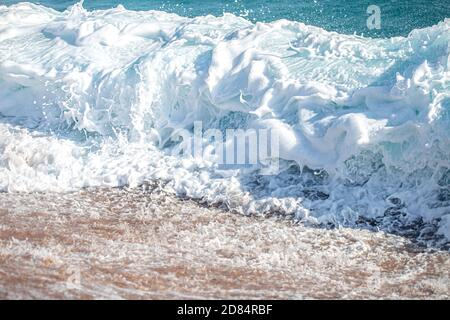 Beautiful raging seas with sea foam and waves. Background of turquoise waves. - Stock Photo
